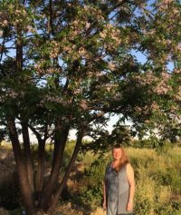 photo of Judy with lilac tree